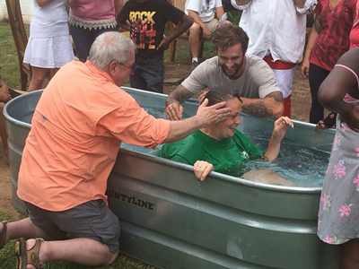 Ron Gibson baptizing at House on 4th